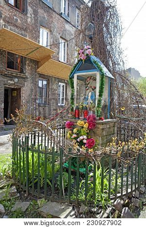 WARSAW, POLAND Small shrine with Our Lady statue in Ochota district of Warsaw, Poland stock photo
