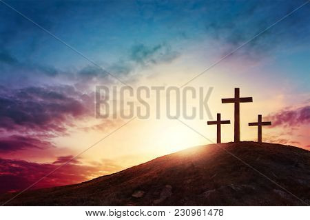 Silhouette Cross On Calvary Mountain Sunset Background. Easter Concept