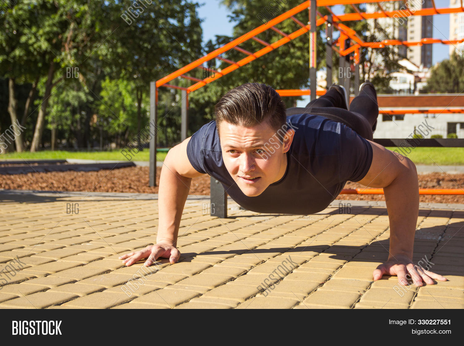 active,activity,adult,arm,athlete,athletic,attractive,body,bodybuilding,caucasian,effort,energy,exercise,fit,fitness,gym,handsome,health,healthy,indoor,lifestyle,male,man,masculine,masculinity,men,muscle,muscular,one,outdoor,outside,people,person,physical,power,push,push-up,pushup,shape,sport,sportive,strength,strong,summer,training,up,weight,workout,young