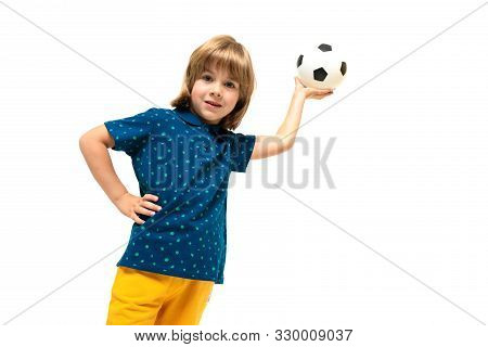 Picture of a teenage caucasian boy holds a soccer ball in one hand isolated on white background. stock photo