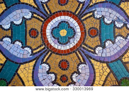 Vintage texture. Detail of beautiful old collapsing abstract ceramic mosaic adorned building. Mosaic decorative background. Abstract pattern, colored ceramic stones. stock photo