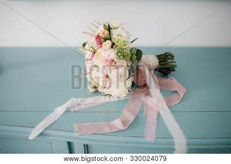 beautiful wedding bouquet of different flowers on a chair stock photo