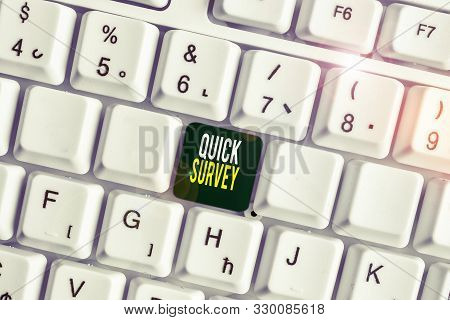 Handwriting text Quick Survey. Concept meaning Conduct fast check on condition value situation of something White pc keyboard with empty note paper above white background key copy space. stock photo