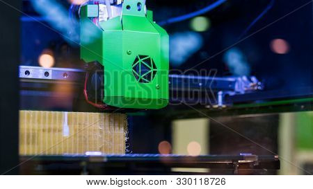 Print head of 3D printer machine printing plastic model at modern scifi technology exhibition. 3D printing, additive technologies, 4.0 industrial revolution and futuristic concept stock photo