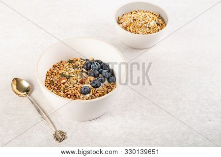New vegan healthy snack from quinoa granola, this is nutritionally enhanced quinoa based breakfast alternative, free from gluten, grains, dairy and refined sugar stock photo