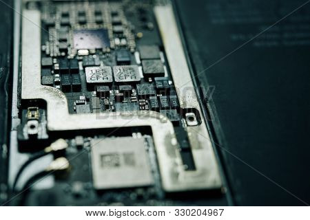 Detail close-up image of smartphone logic panel with system components stock photo