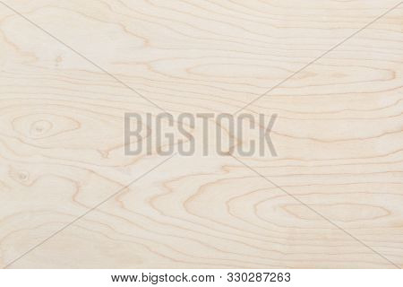 Natural beige wood texture background. Wavy textured plywood, a lot of fiber and small chips, close-up abstract tree background for design, decor and skins stock photo
