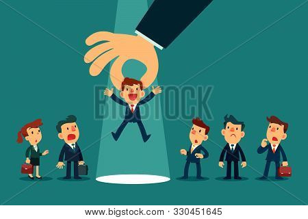 Employer hand choosing a businessman by pick him up from a group of business people. Business recruitment. Business competition concept. stock photo