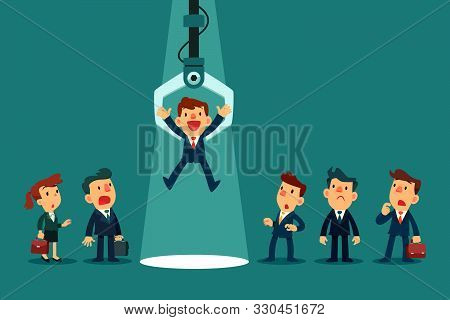 Robotic claw choosing a businessman from a group of business people. Business job competition and recruitment concept. stock photo