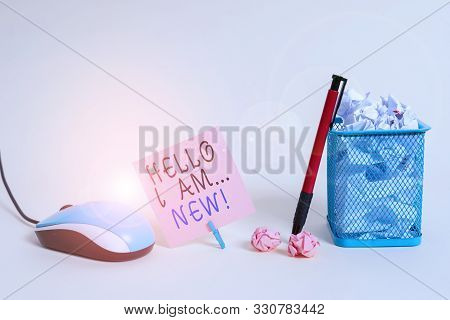 Handwriting text writing Hello I Am New. Concept meaning used as greeting or to begin telephone conversation Plain note paper and stationary placed above soft pastel colour backdrop. stock photo