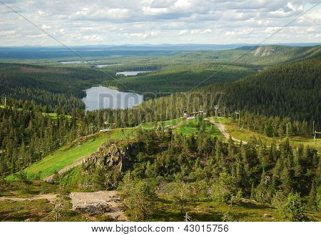 Rukatunturi is a 490 metres high fell and a ski resort in Kuusamo in the middle of lakes and evergreen forests of Finland. stock photo