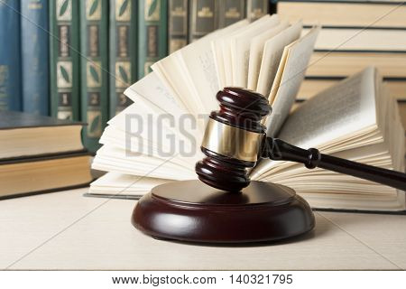 Law concept - Book with wooden judges gavel on table in a courtroom or enforcement office stock photo
