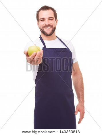 Happy man with blue apron and green apple on white background stock photo