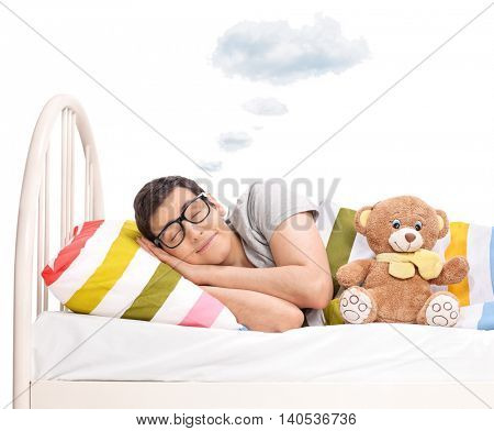 Joyful man sleeping with teddy bear and dreaming with a cloud above his head isolated on white background stock photo