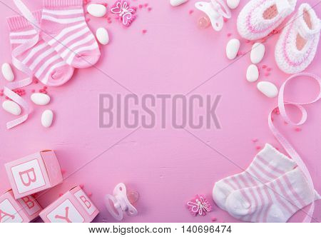 Its a Girl pink theme Baby Shower or Nursery background with decorated borders on pink wood background. stock photo
