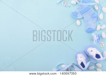 Its a boy blue theme Baby Shower or Nursery background with decorated borders on pale blue wood background. stock photo
