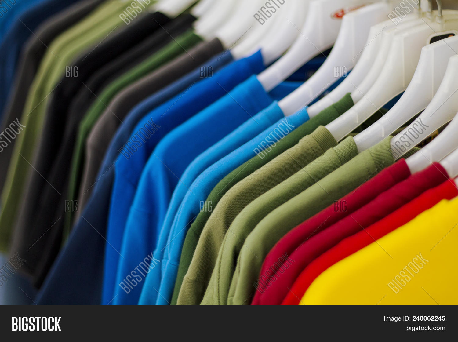 9c29e54a194 🔥 Colorful T-shirts On Hang For Sale In Shop. Multicolored Summer ...