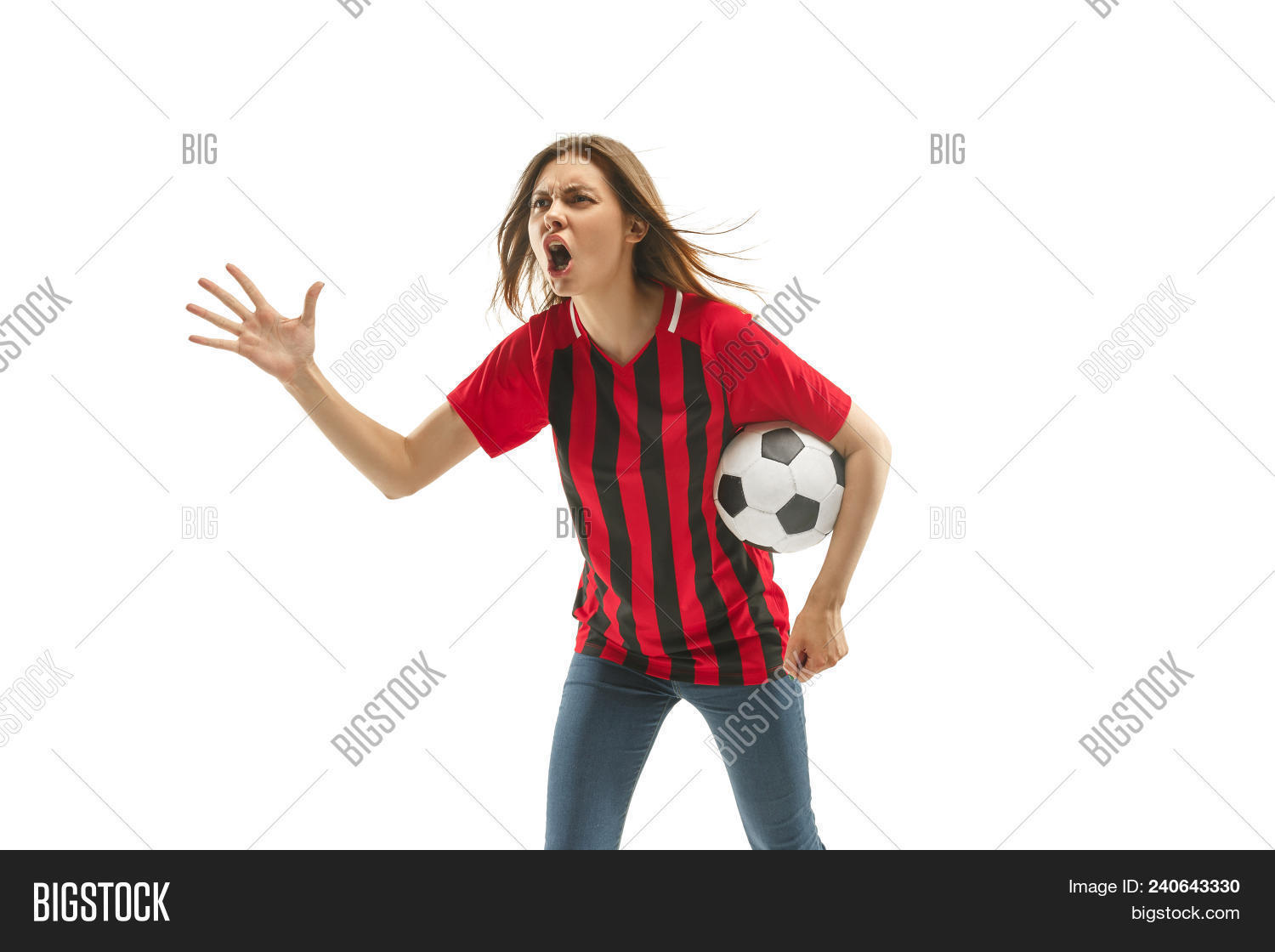 Belgian female fan celebrating on white background. The young woman in soccer football uniform as winner with ball isolated at white studio. Fan, support concept. Human emotions concept.