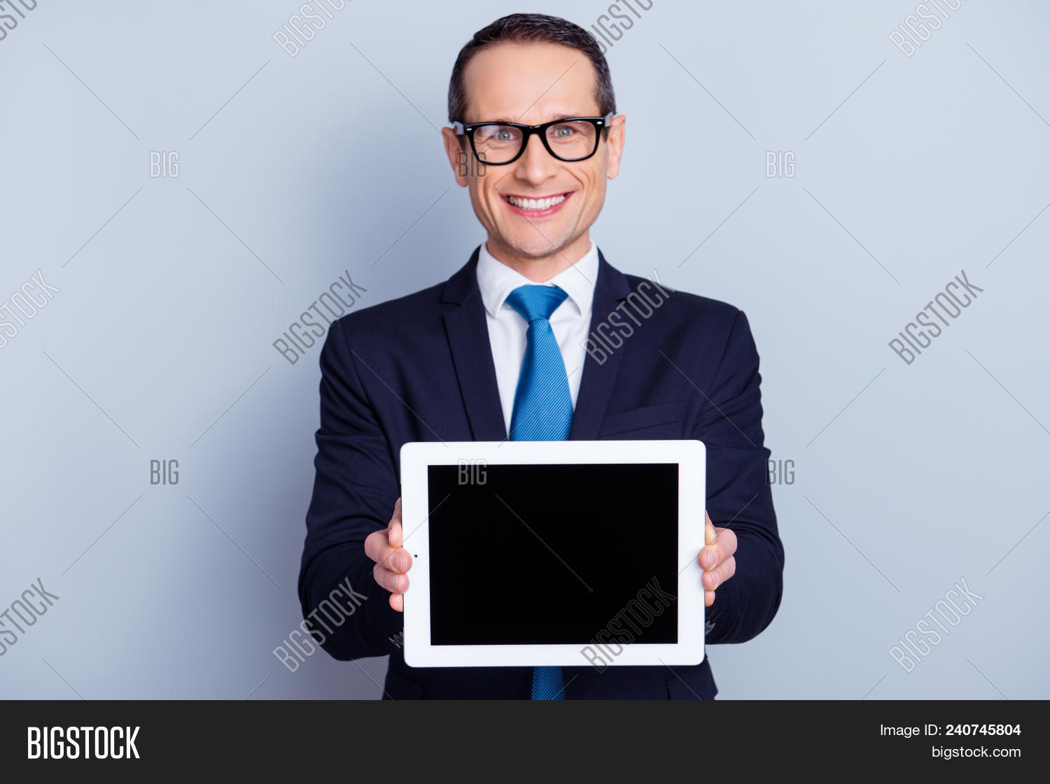 adult,advertising,aging,black,blank,business,businessman,computer,copy,corporate,education,email,empty,entrepreneur,eyewear,formal-wear,glasses,happy,innovation,internet,jacket,job,laptop,male,man,manager,mature,modern,monitor,presentation,product,professional,promotion,representative,screen,show,smiling,software,space,spectacles,successful,suit,tablet,teacher,technology,touchscreen,trend,tuxedo,work,worker