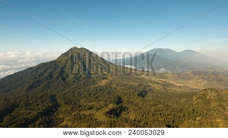 Mountain landscape, clouds, relief. Aerial view of Green tropical mountain cover with cloud Banyuwangi Regency of East Java, Indonesia. stock photo
