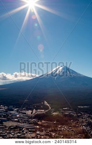 Mount Fuji in winter season with sun like a Star; the nice sky with lense flare at Kawaguchiko stock photo