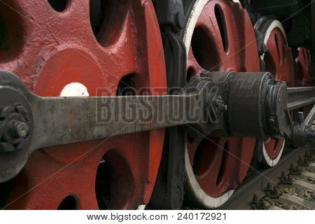 wheels of an old functioning steam locomotive with drawbar and crank mechanism closeup stock photo