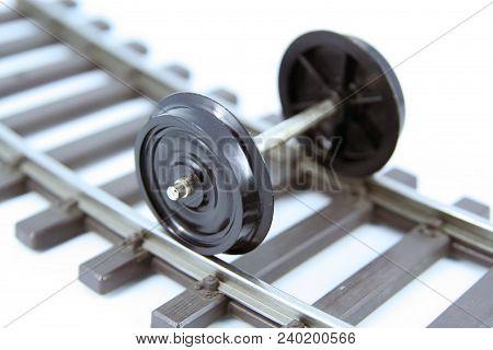 Train toy wheels. Train model wheels. Train wagon miniature model wheels. Train wheels on a railway. stock photo