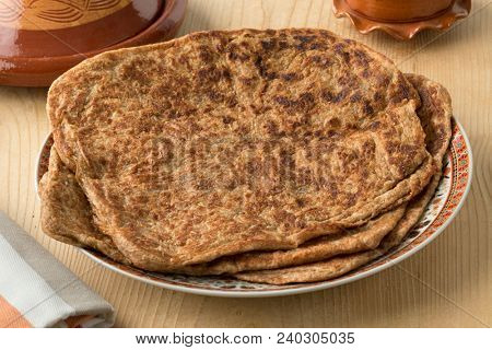 Dish with traditional Moroccan whole grain pancakes named msemen  stock photo