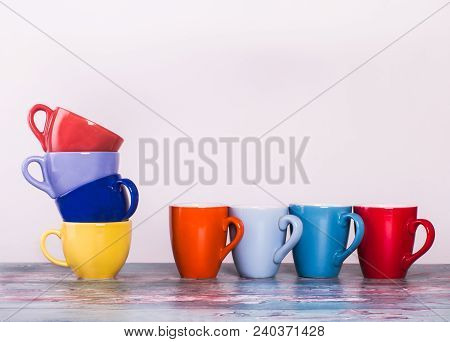 Matching of eight cups of coffee with different vibrant colors and form on the white background. Cooperation or competition concept. stock photo