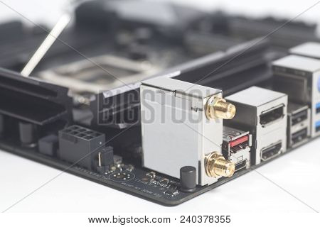 computer motherboard Intel LGA 1151 cpu socket and other details isolated on white background stock photo