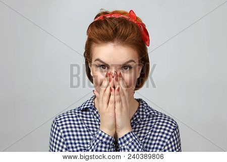 Picture of emotional beautiful young lady in fashionable clothes covering mouth, amazed with unexpected gift from boyfriend, her eyes expressing excitement and amazement. True emotions and feelings stock photo