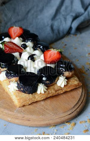 Cake of Saint-onore from puff pastry, profiteroles, currant cream and whipped cream. Classic French dessert. An exquisite confectionery product. stock photo
