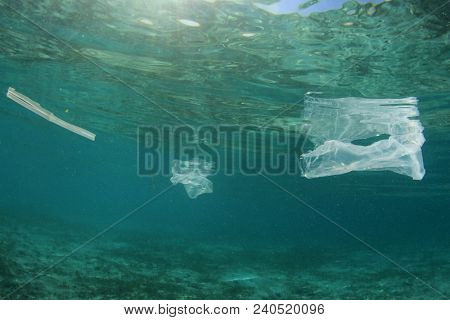Plastic ocean pollution. Plastic bags, bottles and straws pollute sea stock photo