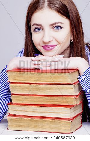 Young Beautiful Woman With Ile Of Books. Concept Of E-learning, Distance Studying And Self Education