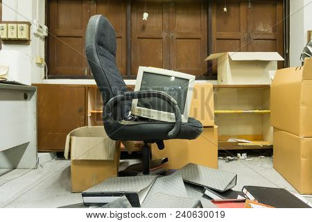Dirty, messy and abandoned office, poor light stock photo