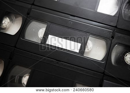 flatlay of  VHS or VCR Video cassette tape with blank white label. stock photo