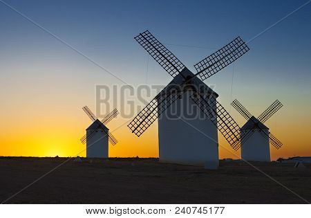 Traditional windmills at rising, Campo de Criptana, La Mancha, Spain stock photo