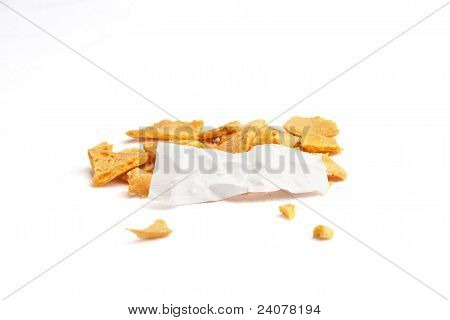 Crumbled fortune cookie with wrinkled blank fortune against white background stock photo