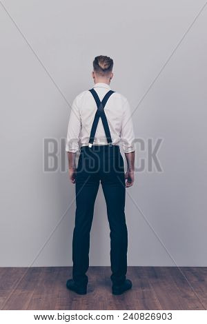 Vertical full-size full-length behind back rear view photo of handsome strong powerful confident handsome masculine virile guy wearing black pants white shirt isolated on gray background stock photo