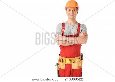 Cheerful construction worker in uniform with folded arms isolated on white stock photo