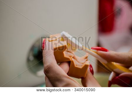 Jeweler working with wax model ring in his workshop. Craft jewelery making. Close up stock photo