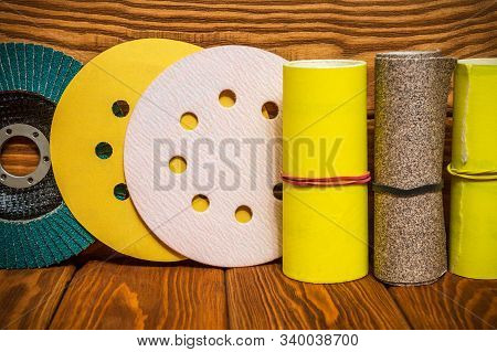 Set of abrasive tools and yellow sandpaper on vintage wooden background stock photo