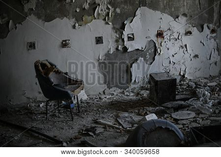 empty destroyed room with chairs and broken walls during war conflict or technogenic catastrophe stock photo