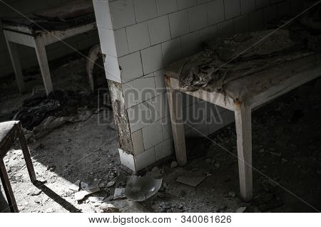 empty abandoned hospital with bed and broken glass in war zone or technogenic accident stock photo