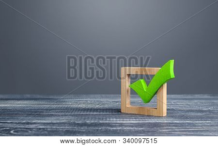 Green voting tick in a box. Checkbox. Democratic elections, referendum. The right to choose, change of power. Checklist for verification and self-discipline. Necessary quality criteria approval symbol stock photo