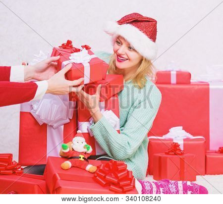 Opening christmas gift. Girl near christmas tree happy celebrate holiday. Woman excited blonde hold gift box with bow. Perfect gift for girlfriend or wife. Santa bring her gift that she always wanted stock photo