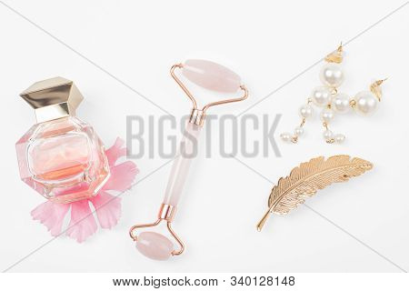 Jade roller for face massage. Jade face roller for beauty facial massage therapy stock photo