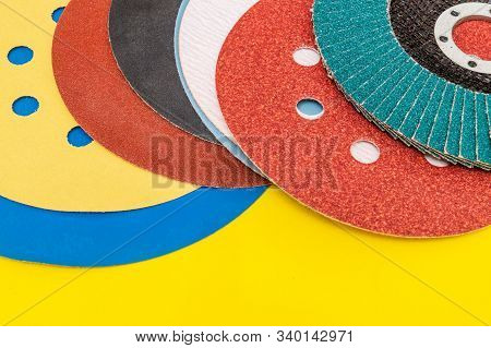Set of abrasive tools and sandpaper on yellow background stock photo