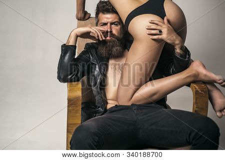 Dominant man smoking. Portrait of couple. Love and trust. Pose for family portrait. Isolated on grey. Attractive man and woman being playful. Fashion studio photo of beautiful couple stock photo