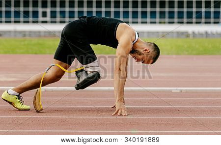 disabled athlete amputee leg start sprint running in athletics stock photo